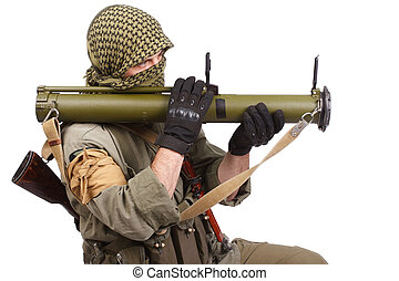 insurgent wearing keffiyeh with anti-tank rocket launcher...