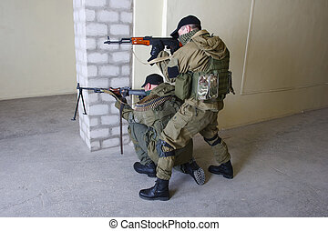 insurgents with AK 47 ang RPD gun inside the building