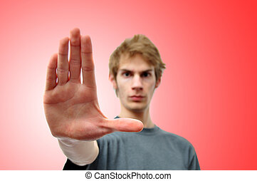 Stop - A person holding his hand up with red background with...
