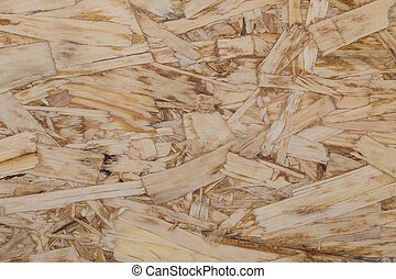 Pressed Sawdust Panel - Close up of a recycled compressed...