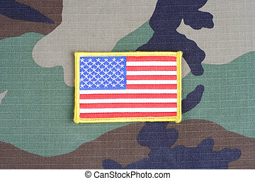 US flag patch on woodland camouflage uniform