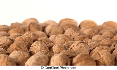 A lot of walnuts, on white, rotation - A lot of delicious...