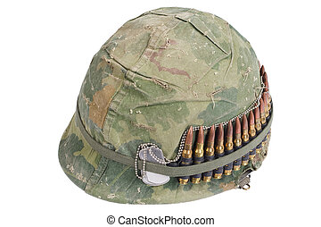US Army helmet with camouflage cover and ammo belt and dog...