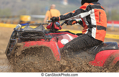 ATV race abstract - Detail of an ATV during the muddy...