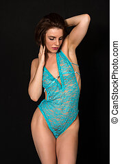 Bodysuit - Pretty petite brunette in a sheer turquoise...