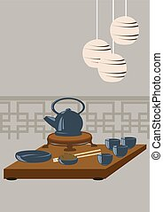 Japanese tea set on a wooden table, round lamps