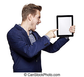 Angry young man pointing at tablet PC