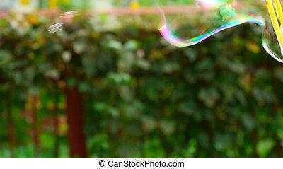 Soap bubble - Male blow soap bubbles, slow motion