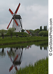 Windmill along Canal - Windmill along canal with reflection...