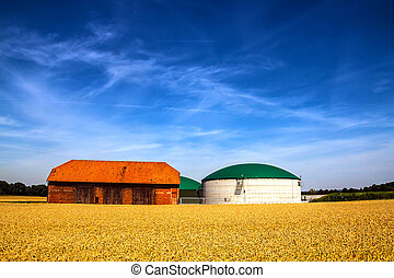 Barn and biogas plant - Biogas silo plant and a barn on a...
