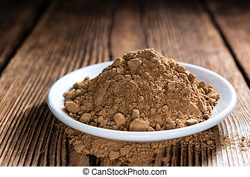 Portion of Guarana Powder on dark wooden background...