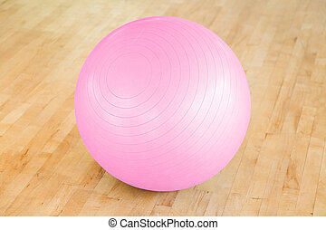 Pilates ball - Closeup of a pink swiss ball in a gym