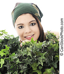 Smiling above the Foliage - Close-up of a beautiful teen...