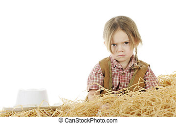 Angry Little Cowgirl - An angry preschool cowgirl sitting...