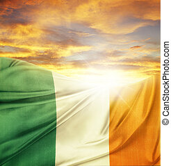 Flag and sky - Irish flag in front of bright sky