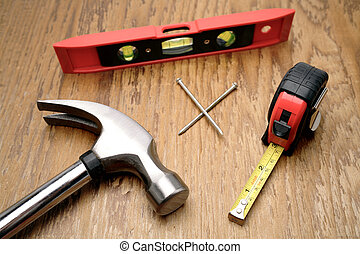 Work tools - Assorted work tools on wooden panel