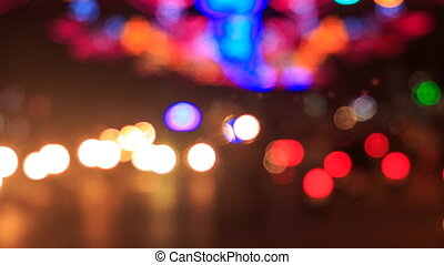 motion of colourful blurred and defocused lights of city...