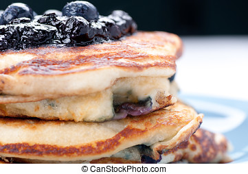 blueberry pancakes - a stack of blueberry pancakes with...