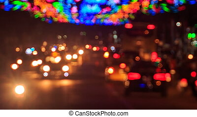 motion of colourful blurred defocused lights of city traffic...