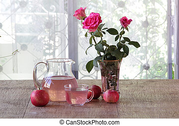 Compote from fresh apples in a transparent jug on a wooden...