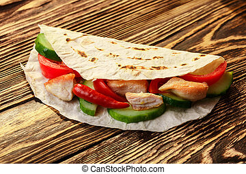 Gyros pita - Traditional gyros pita wrap with chicken and...