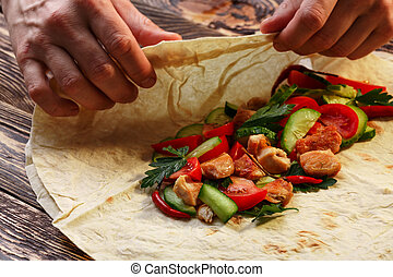Shawarma - Wrapping traditional shawarma wrap with chicken...