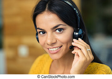 Businesswoman with headphones - Closeup portrait of a...