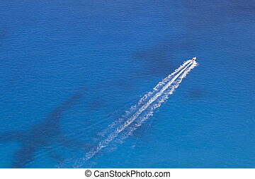 Motorboat Floats in the Sea - Aerial image of motorboat...