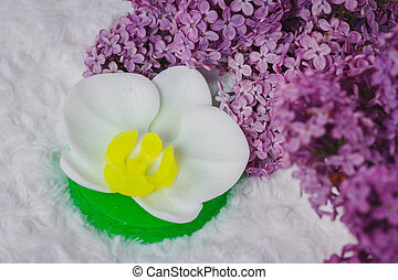 Handmade soap formed like orchid