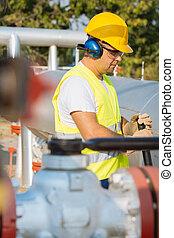 Oil worker in industrial oil