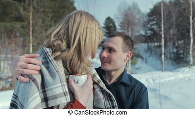 Young couple in love on a winter