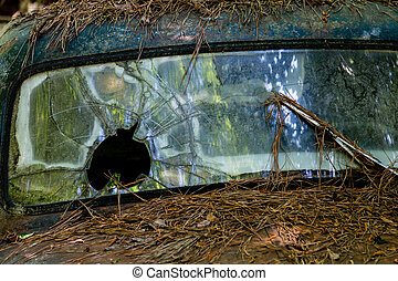 Bullet Hole in Windshield - Windshield of an old truck with...