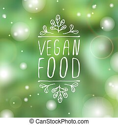 Vegan food - product label on blurred background -...
