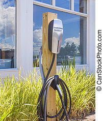 electric car charging station. - Side view of an electric...
