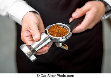 Holding coffee machine holder - Barista holding coffee...