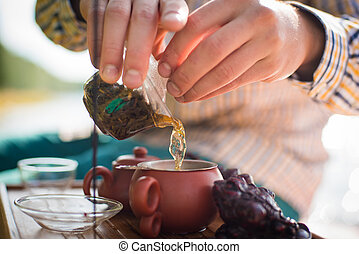 outdoor tea ceremony with antique traditional cup