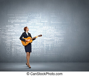 Businesswoman playing acoustic guitar - Cheerful...