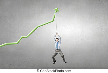 Growing graph - Young businessman hanging on increasing...