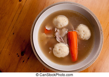 home made matzoh ball soup with carrots and chicken