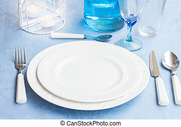 Tableware - set of plates, cups and utencils