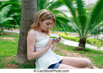 Chatting On Mobile Phone At The Park