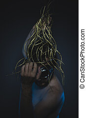 dramatic, depression and anxiety, naked man with a crown of thorns on his head