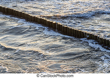wave breakers at the ocean of the baltic sea