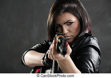 Sexy Girl Aiming - Attractive girl standing in the attitude...