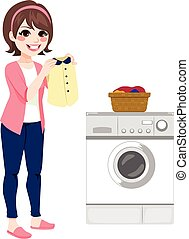 Woman Doing Laundry - Beautiful happy young brunette woman...
