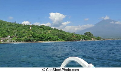 View from boat, lagoon and green coast village Bali,...