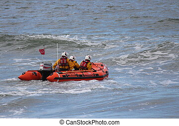 Dinghy Racing into Waves and Surf - Lifeboat dinghy racing...