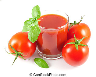 Glass of tomato juice with tomatoes