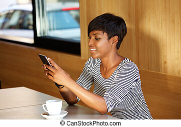Woman reading text message on mobile phone