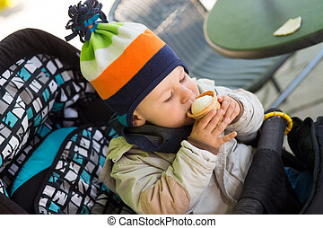 little boy eating an ice cream